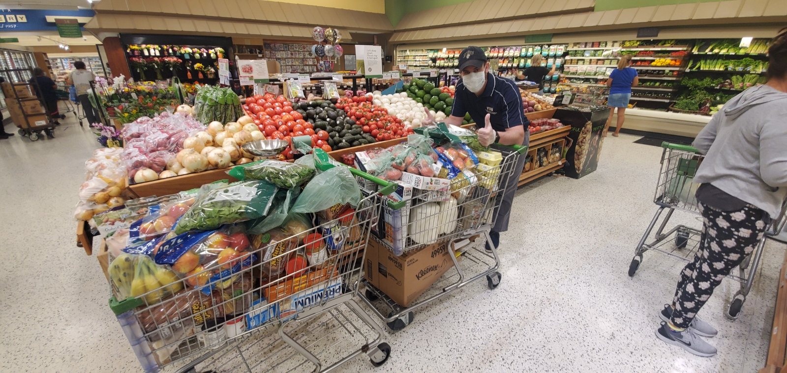 NeighboOutreach Specialist Hansel Frias shopping for groceries for NeighborhoodHELP households.